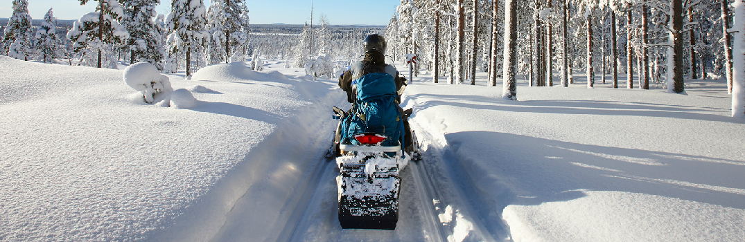 Riding on a Snowmobile Trail