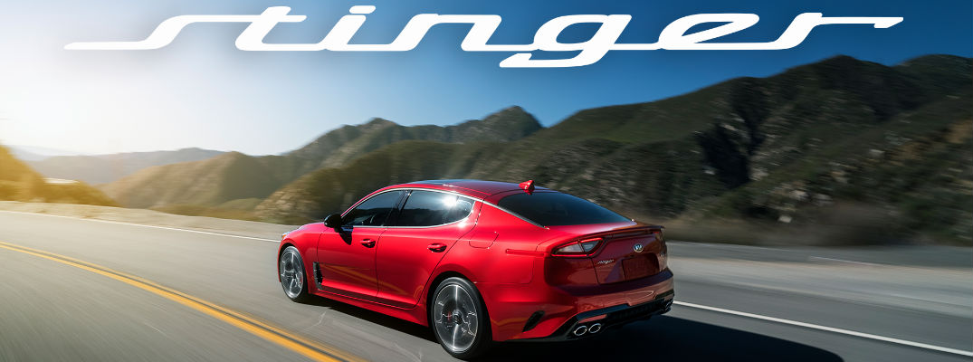 Red 2018 Kia Stinger Rear Exterior on Highway with Stinger Banner
