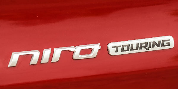 Close Up of 2017 Kia Niro Touring Badge on Red Exterior