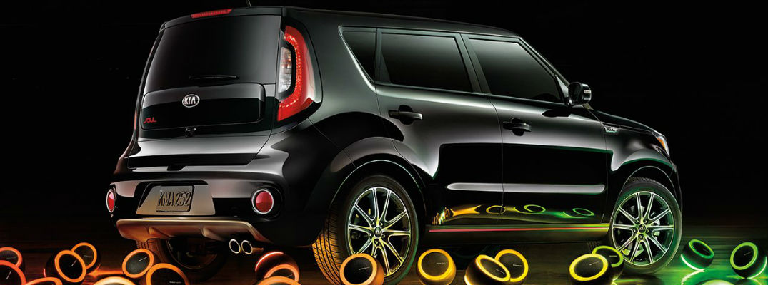Black 2017 Kia Soul with Multi-Colored Speakers on the Ground Around it
