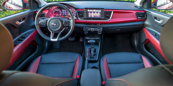 Red and Black Interior of the 2018 kia Rio with View of Dashboard from backseat