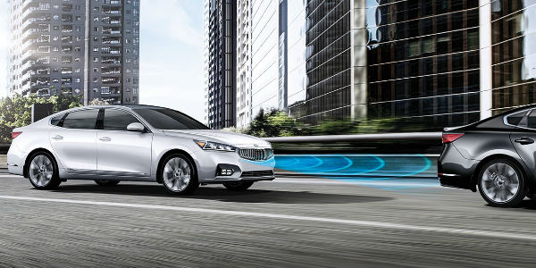 White 2017 kia Cadenza with Advanced Smart Cruise Control on Highway