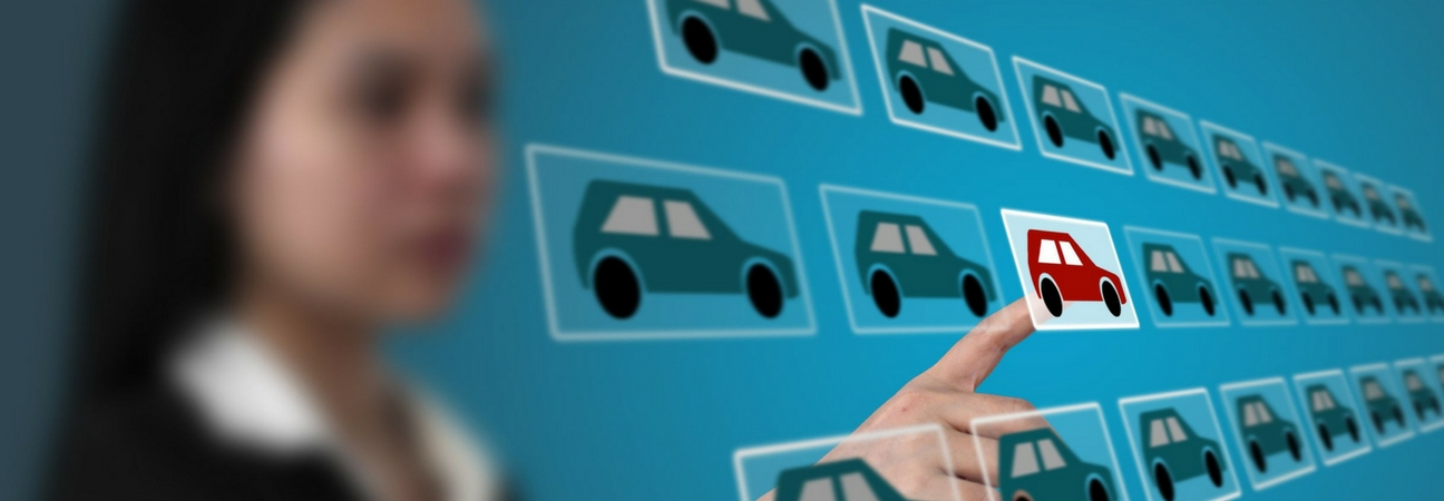 Woman selecting a car on a touchscreen of multiple cars