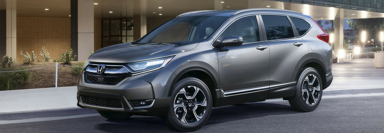 New Honda CR-V parked outside of a building