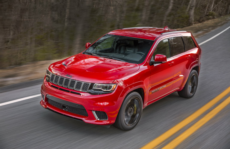 2018 Jeep Grand Cherokee Driving On The Road In Red