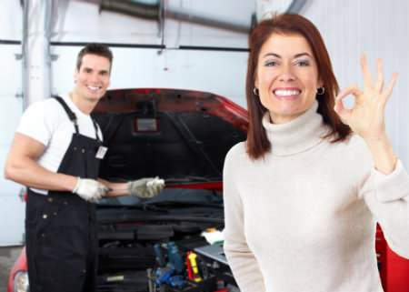 mazda service technician helping driver with service needs