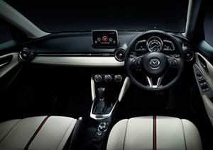 The Mazda 2 Japan Demo steering wheel.