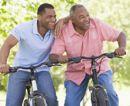 father and son going for a bike ride in the park