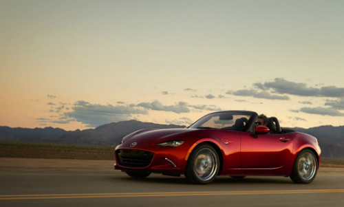 2017 mazda mx-5 miata in red on country raods