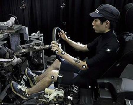 Man sitting to test comfortable driving position