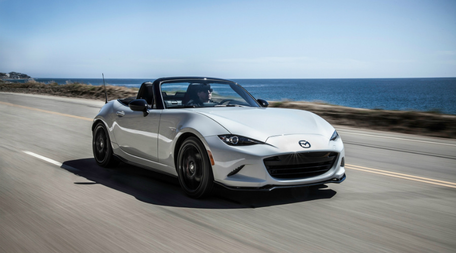 2016 silver MX-5 driving next to a water body