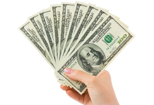 How much is my used car worth? Find out with Ackerman ToyotaHolding Money In Hand