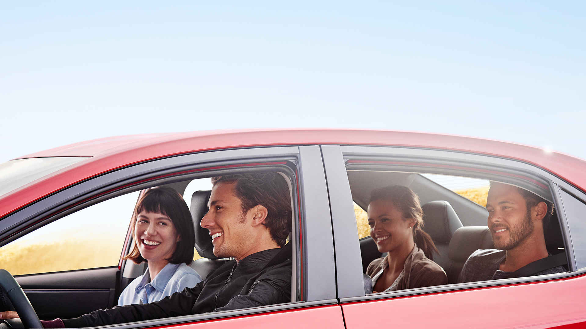 Smiling people in a 2017 Toyota Corolla