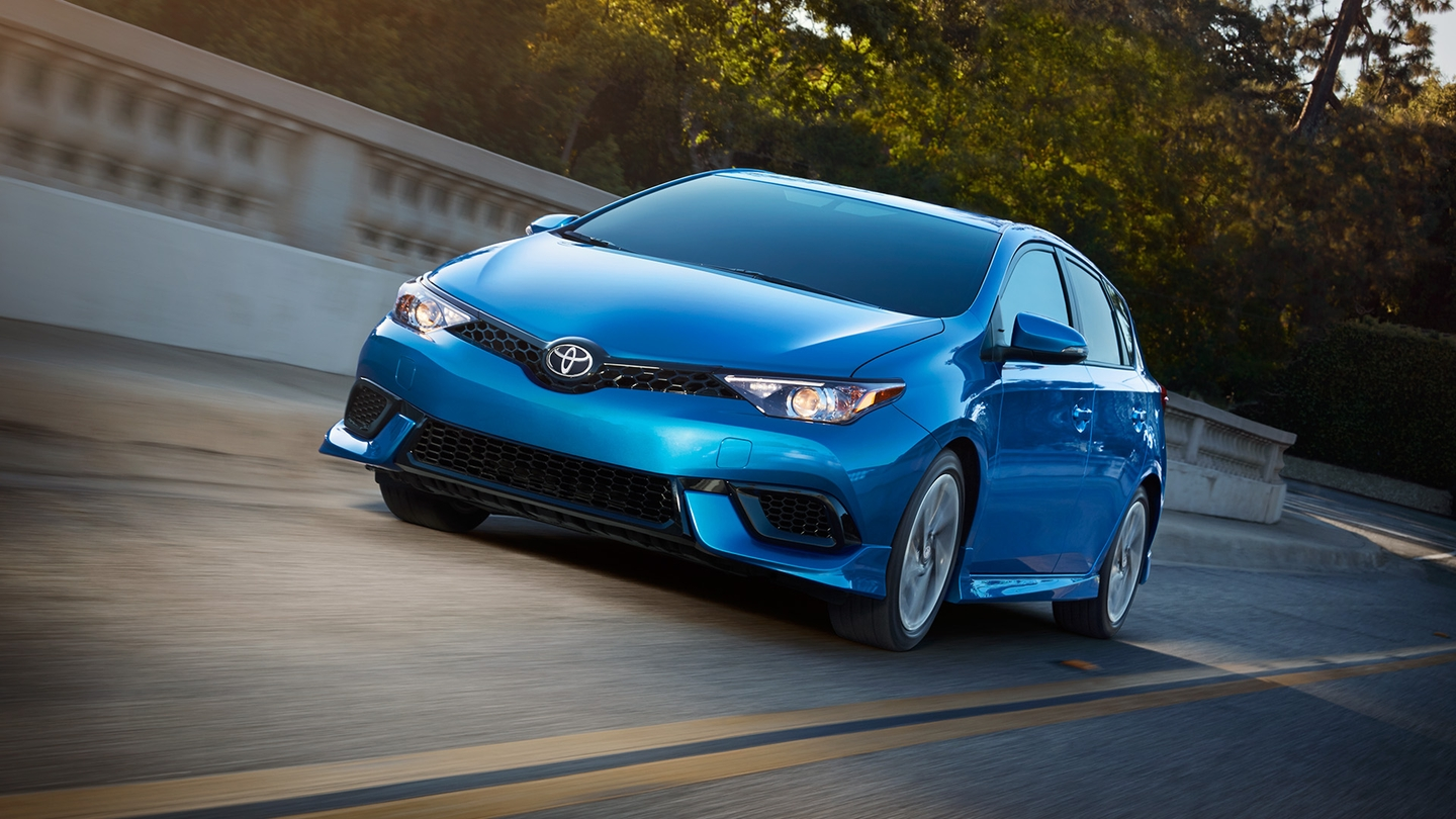 Blue 2017 Toyota Corolla iM driving down the road