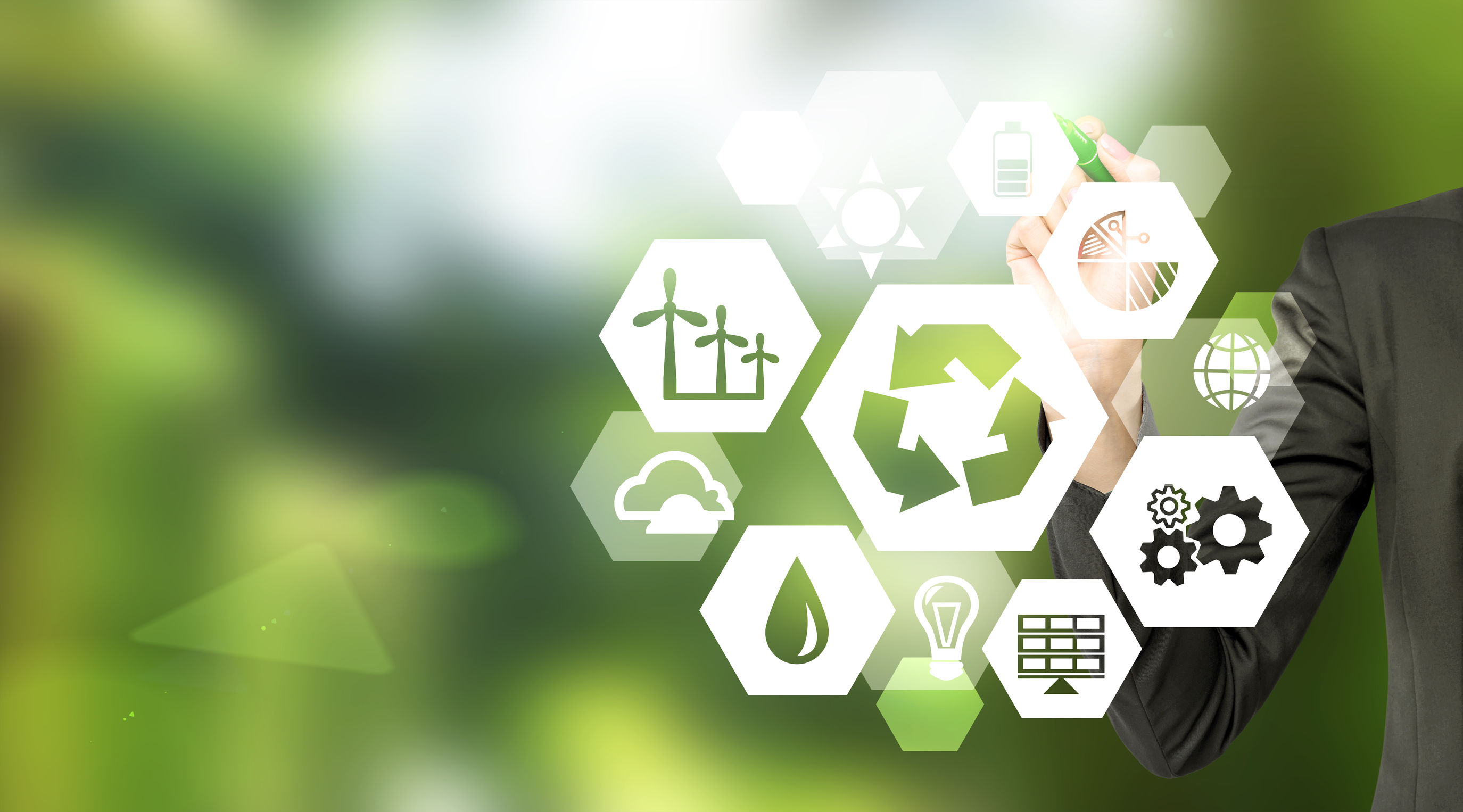 A blurred green background with a circle of hexagons that have symbols associated with the environment