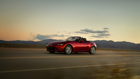red 2016 Mazda MX-5 Miata driving in the evening