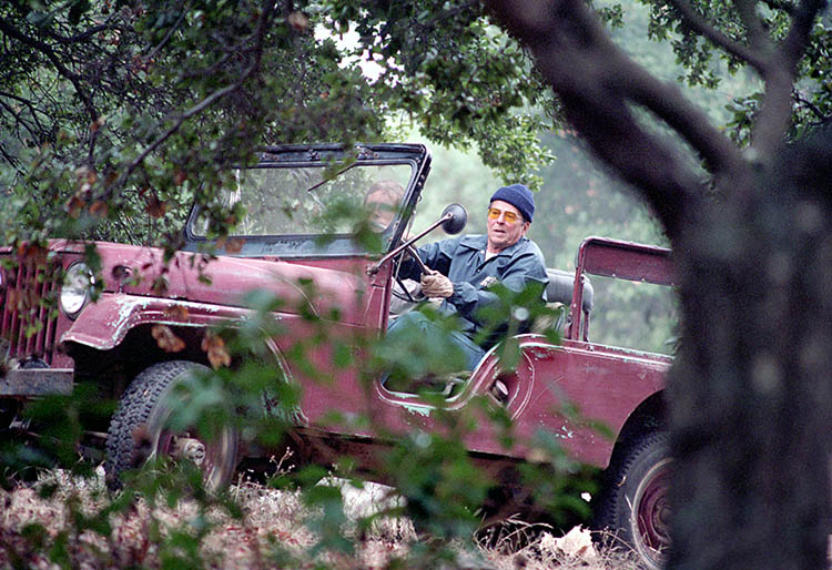 President Reagan ('84) driving in red Willys Jeep at Rancho Del Cielo