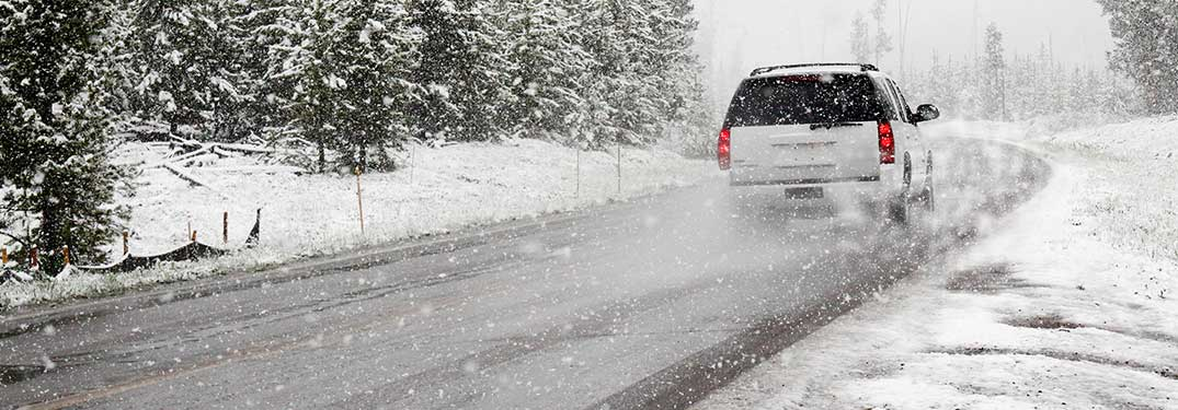 an SUV driving in snow