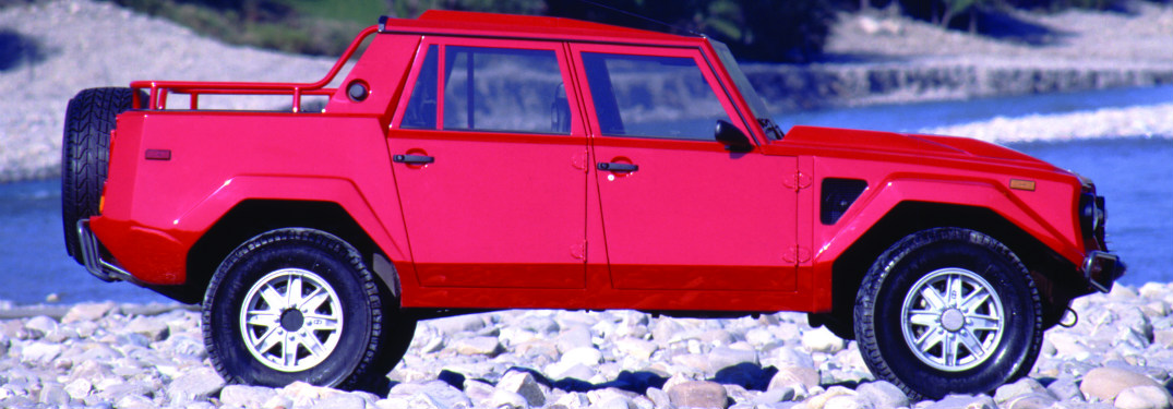 Lamborghini LM002 red on rocks side view