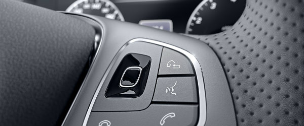 What s new in the 2017 mercedes benz e class for Mercedes benz steering wheel control buttons