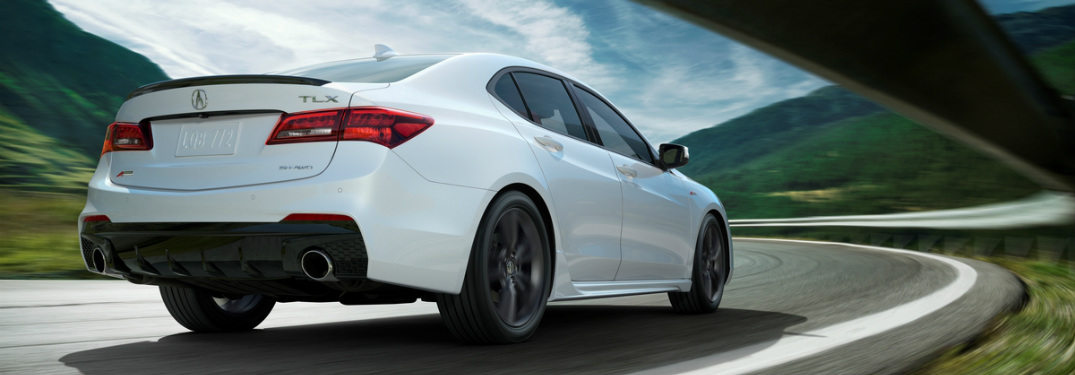 2018 Acura TLX going around a curve rear view