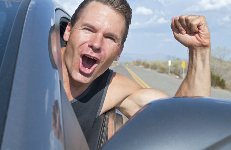 Man Feeling Freedom While he Drives