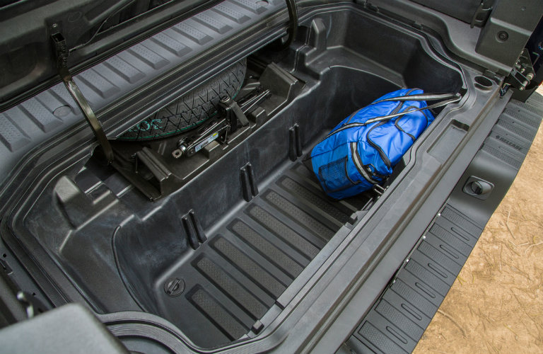 2017 Honda Ridgeline In-Bed Trunk with one blue bag in it