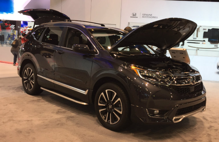 dark Honda CR-V with its liftgate and hood open at the 2017 Chicago Auto Show
