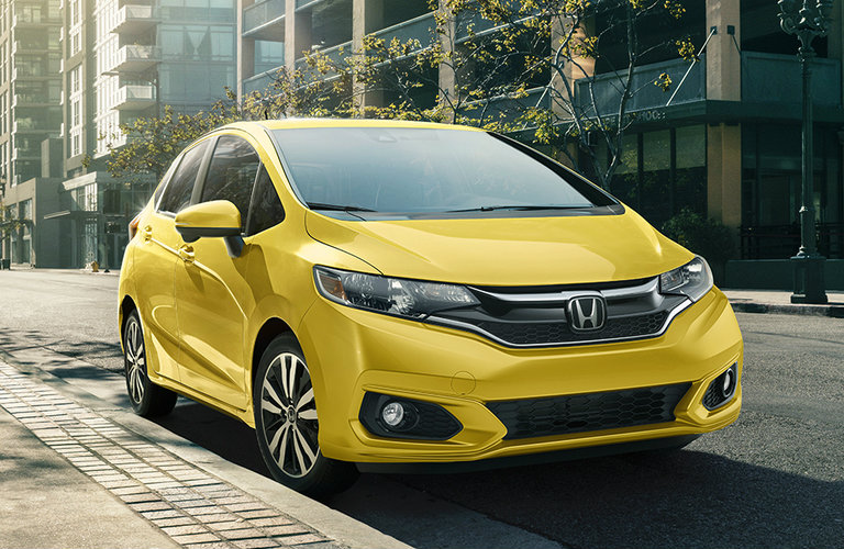 yellow 2018 Honda Fit EX-L driving in the city