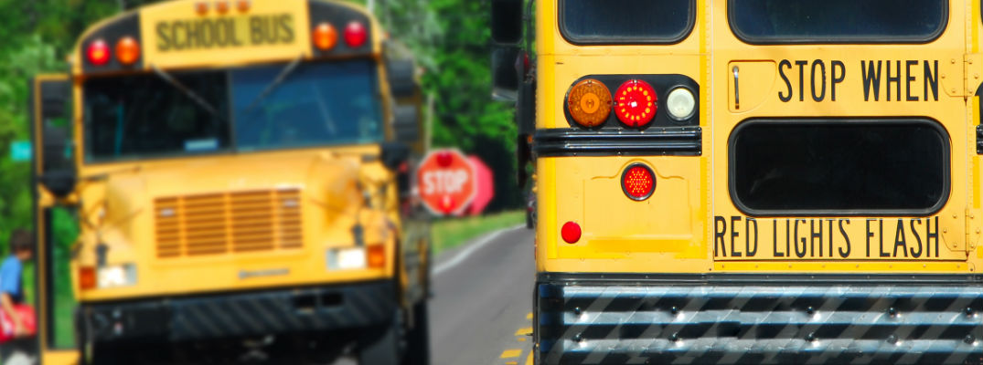 Should I stop for a school bus on a two-lane road?