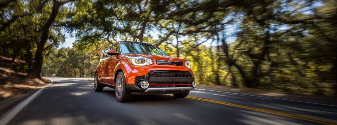 The Kia Soul in motion down the road using its turbocharged engine for max performance