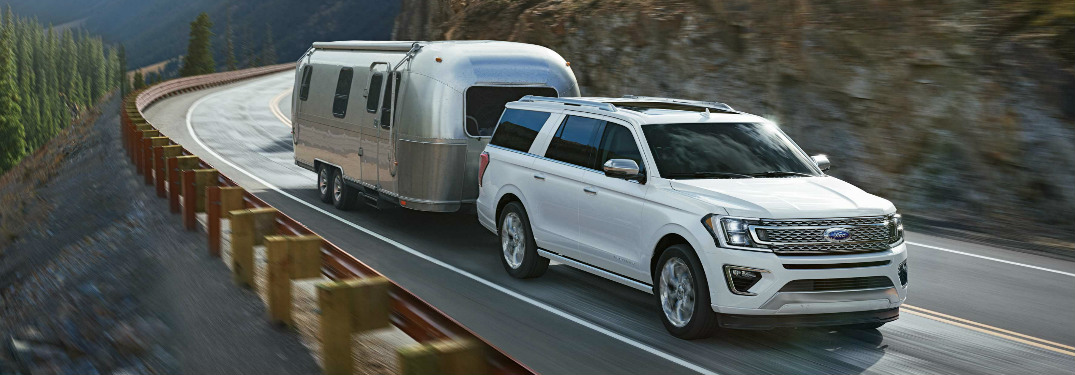 2018 Ford Expedition towing trailer on mountain highway