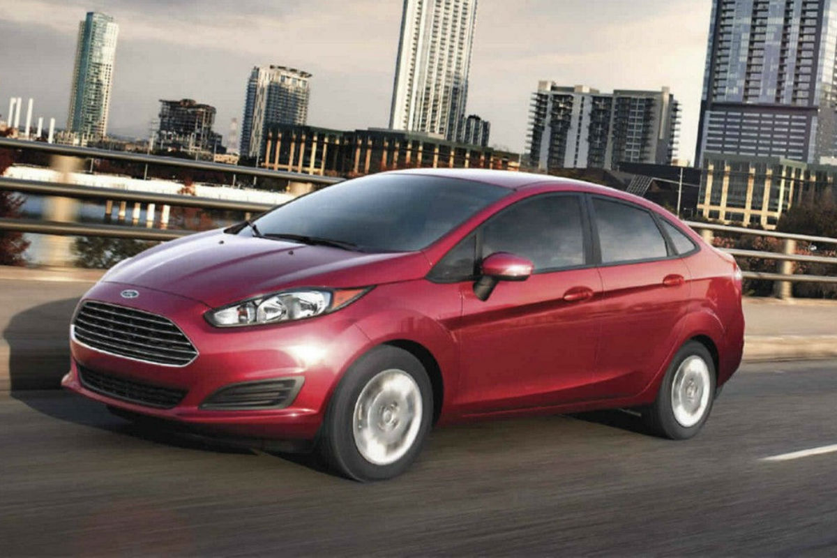 Driver Side profile exterior view of red 2017 Ford Fiesta