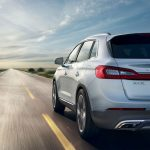 Rear Driver side quarter panel view of Grey 2017 Lincoln MKX