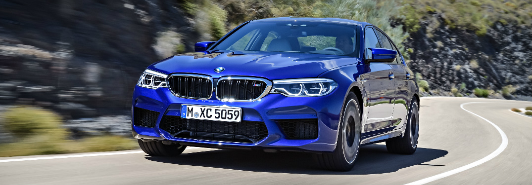 What is the 0-60 mph time and top speed of the 2018 BMW M5?