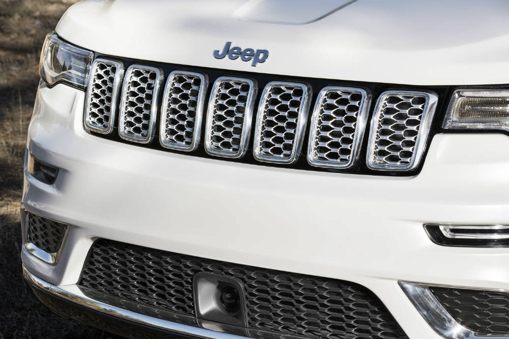 grille view of a white 2017 Jeep Grand Cherokee Summit