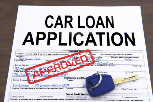 a mock car loan application with an approved stamp on it