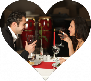 Couple Eating Dinner by Candlelight