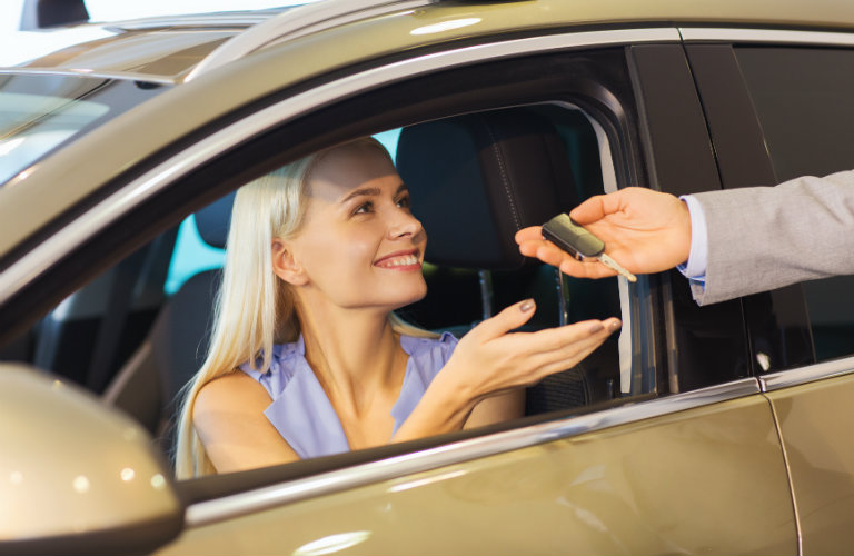 Woman taking the keys to a used car in Listowel, Ontario