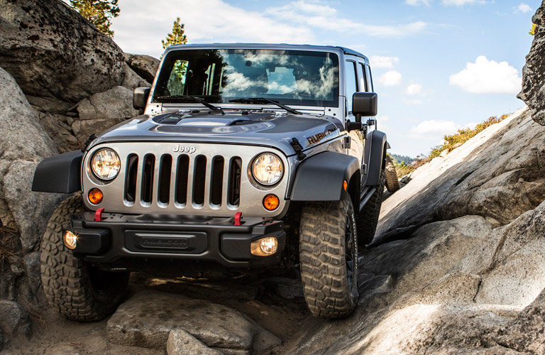 Used Jeep Wrangler on a rocky trail
