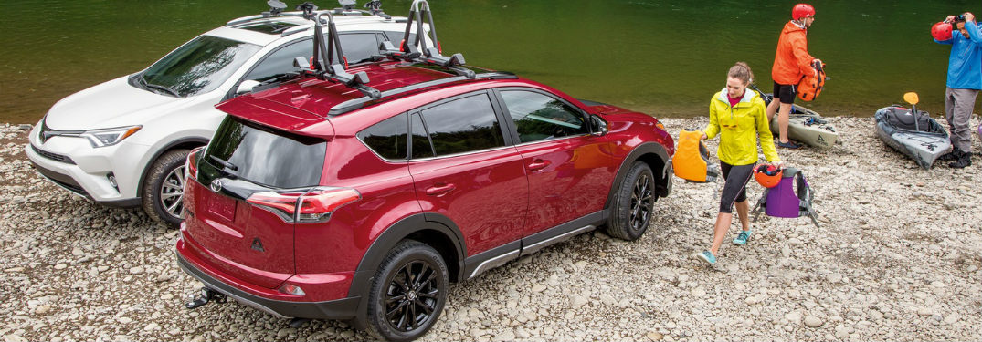 Passenger side exterior view of red 2018 Toyota Rav4