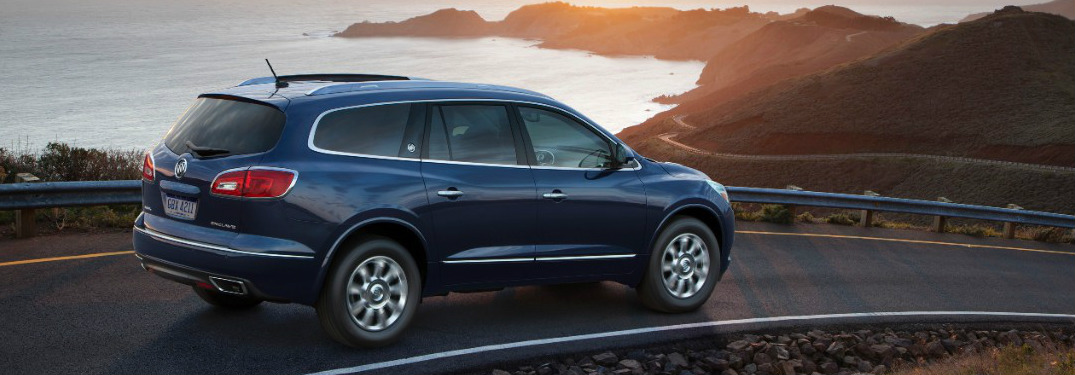 blue 2017 Buick Enclave driving along coastal highway