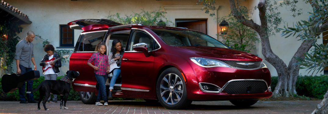 Family and dog near their 2018 Chrysler Pacifica