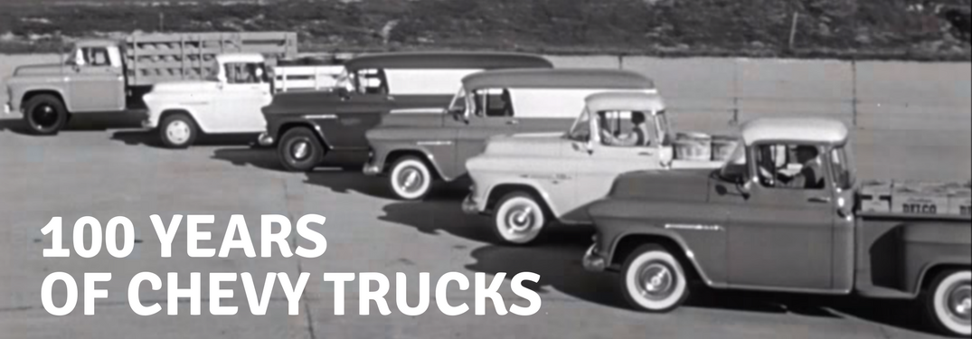 Old Chevy Trucks in a line during commercial