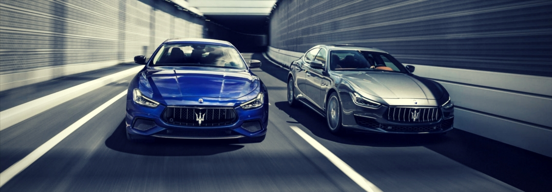 2018 Maserati Ghibli GranLusso and GranSport driving next to each other