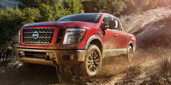 Red 2017 Nissan Titan in muddy area