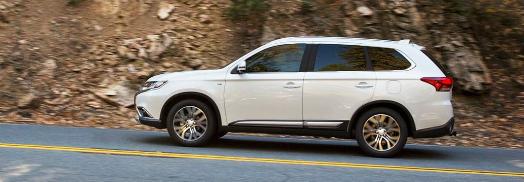 Driver's side exterior view of a white 2018 Mitsubishi Outlander