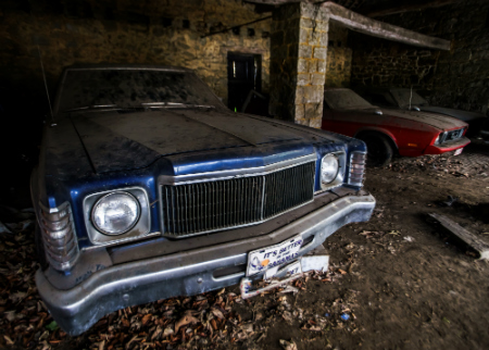 vintage cars hidden in a shed
