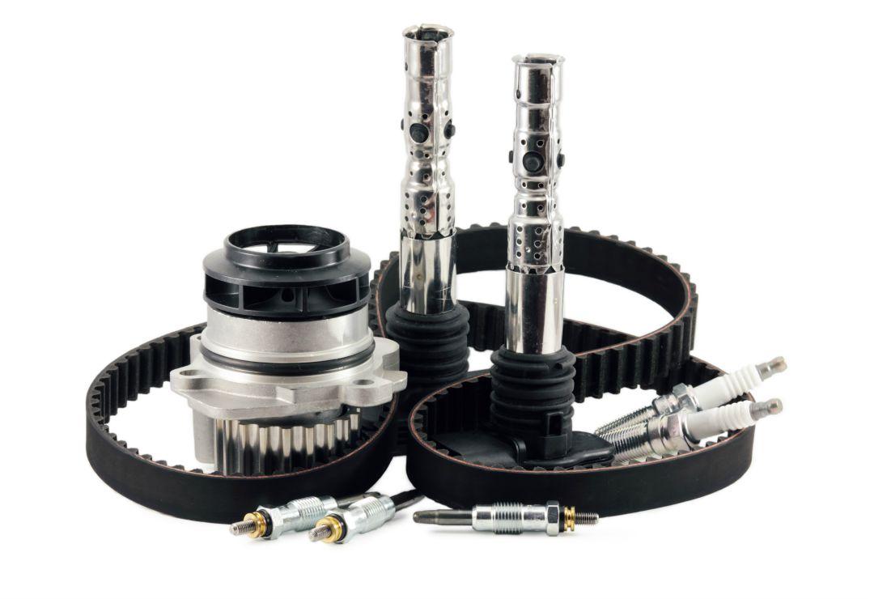 auto parts on a white background belt pump spark plugs