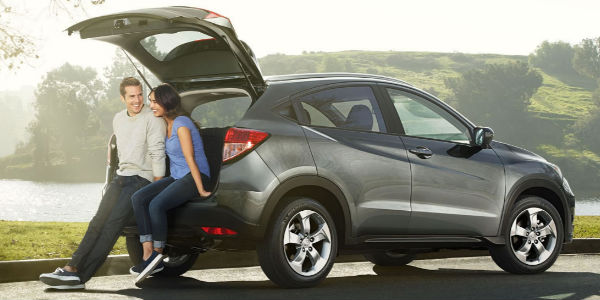 Two People Sitting in the Trunk of a 2017 Honda HR-V in Silver